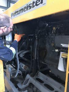 Worker inspecting Putzmeister Equipment Oil System