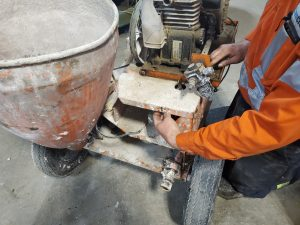 Worker Performing Peristaltic/Squeeze Pump Diagnostics