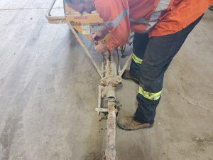 Worker Performing Pump Repair