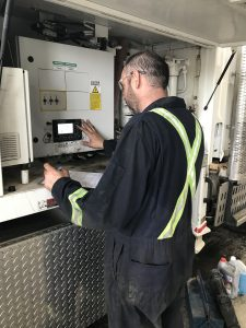 Technician working on a machine panel